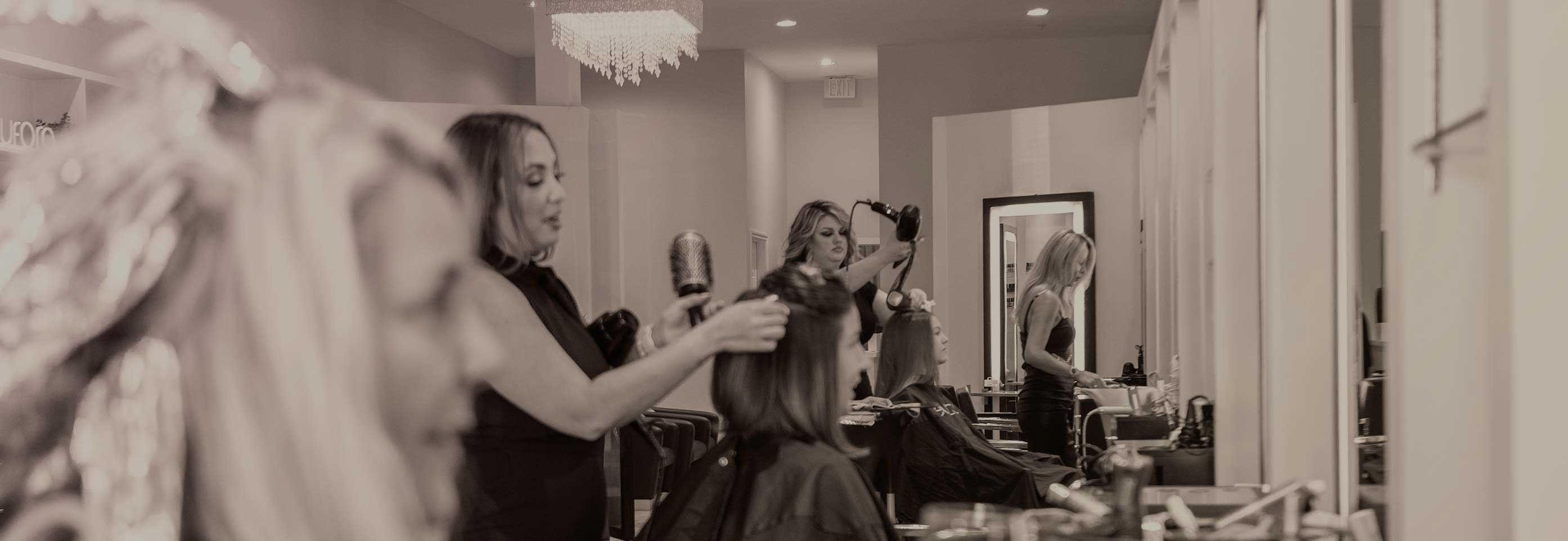 Hair stylists working at The Beauty District in Naples, Florida
